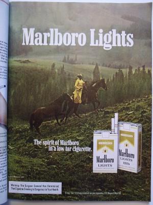 Marlboro-lights-cowboy-leading-horse-rain-yellow-slicker-ad-web